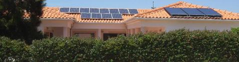 Bom Sucesso front view hedge and solar panels